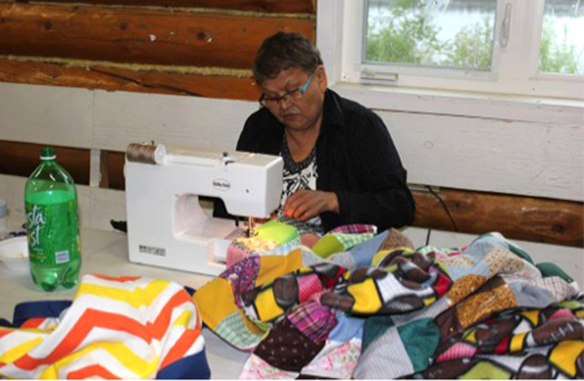 Native woman sewing