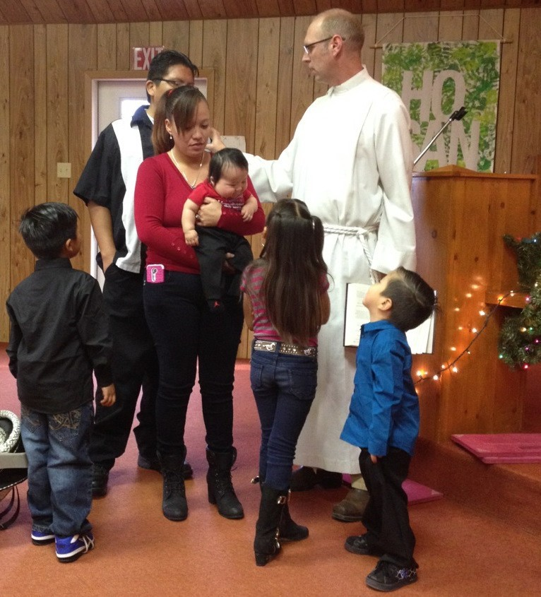 family being baptized