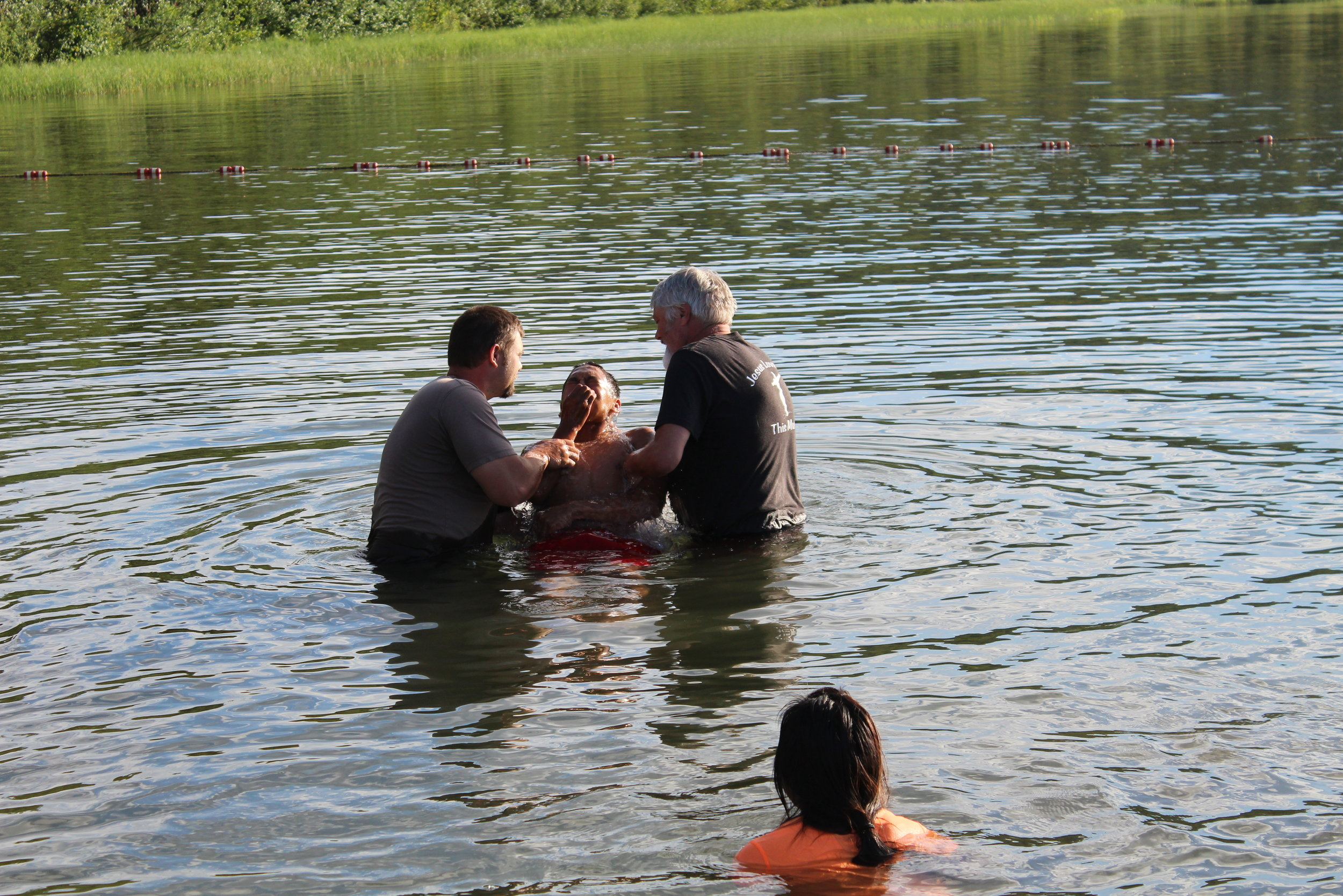 baptism in Lake Bingle Lutheran Indian Ministries Teen Camp