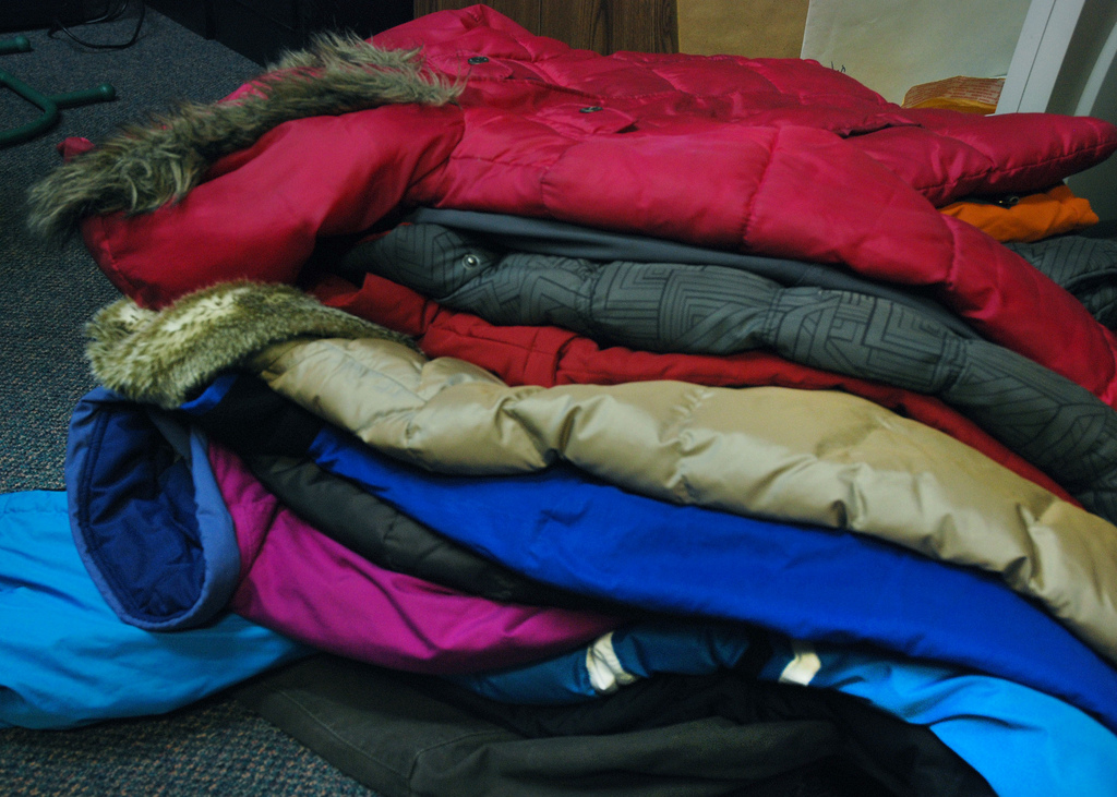 pile of donated winter coats lutheran indian ministries