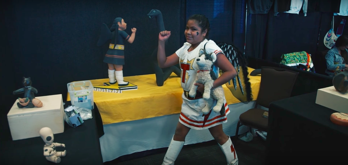 A young fan poses at the 2016 Indigenous Comic Con in Albuquerque, New Mexico. Screenshot from YouTube video by City Alive.