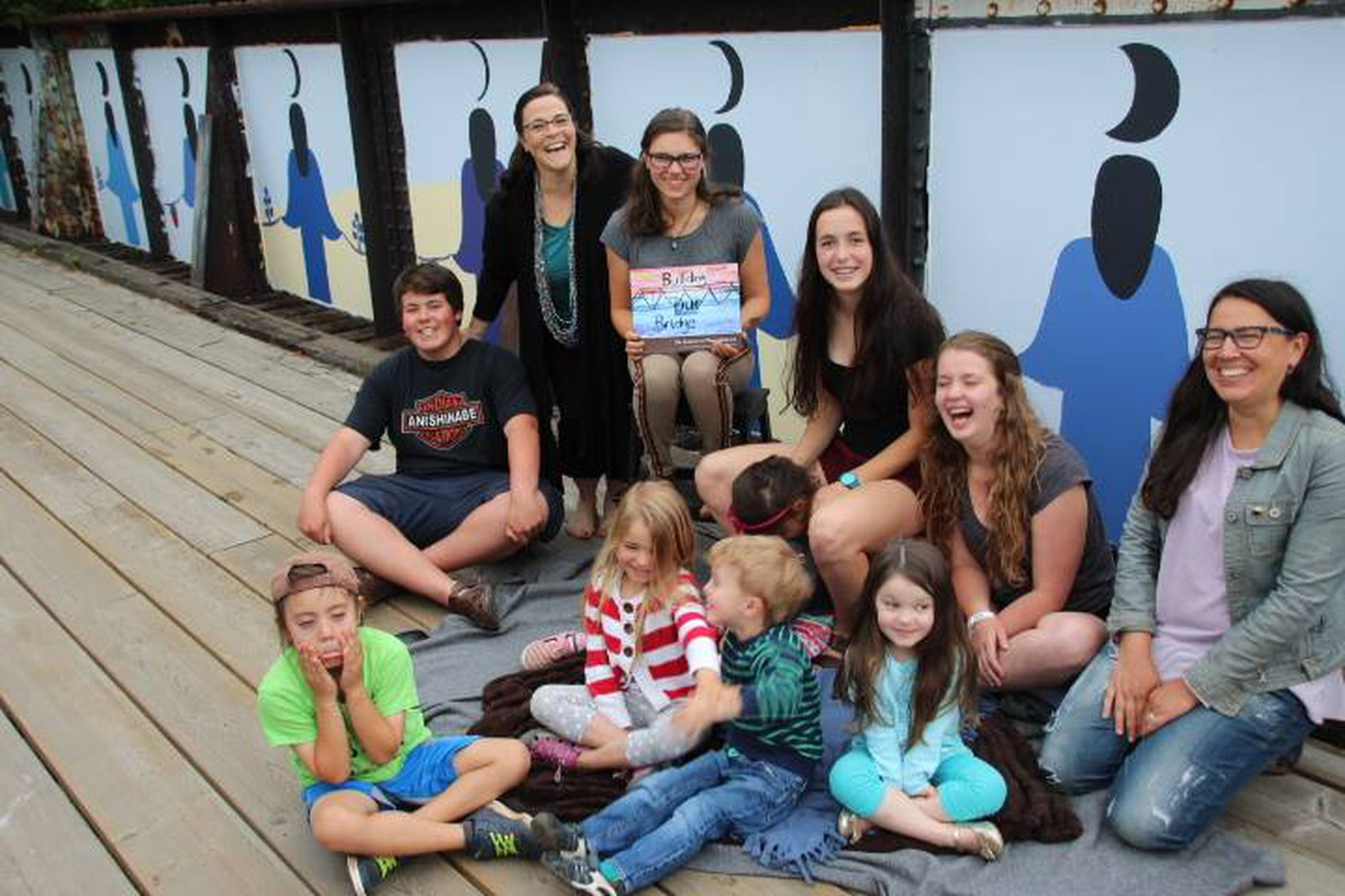 """This Parry Sound group of elementary and high-school students and teachers worked on a 22-page, illustrated children's book about Indigenous culture. """"It's a piece to further the understanding for future generations,"""" says Grade 12 student Mackenzie Elwes."""