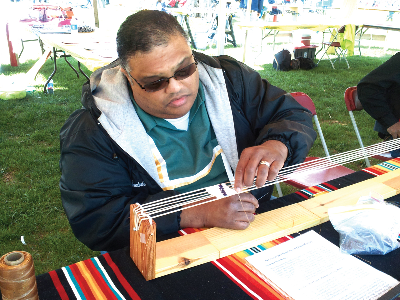 Rev. Dr. J.R. Norwood, pastor of the Ujima Village Christian Church of Ewing and a member of the Nanticoke Lenni-Lenape Tribal Nation, weaves wampum. (Photo from article)