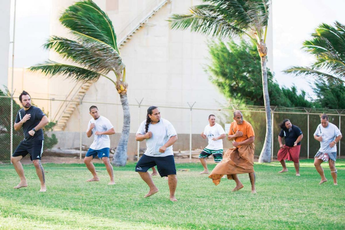 Men of the hale mua interested in a physical pursuit can often be found practicing lua and with Hawaiian weapons on the grassy lawn of the Hale Nanea.  Photo: Rolland Allan & Jessica Marie