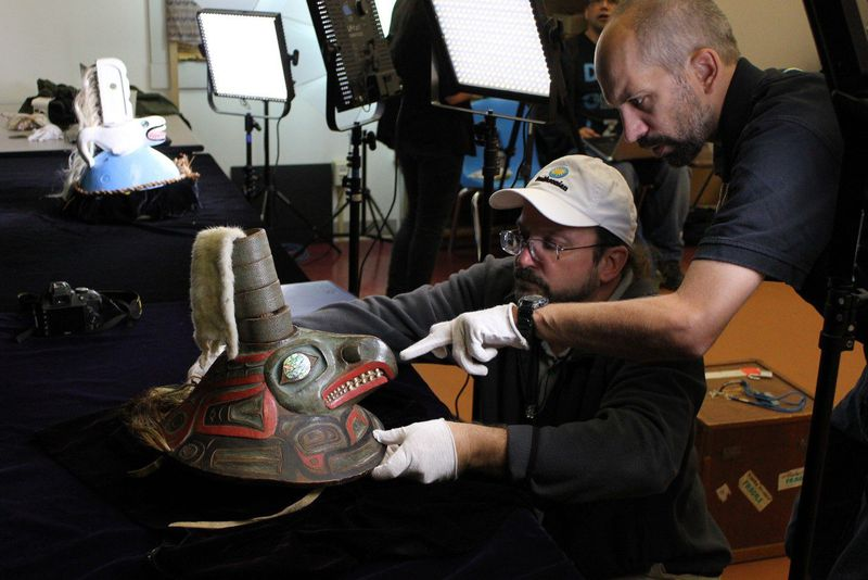 Eric Hollinger (left) and Chris Hollshwander prepare to image the Coho Clan hat. (Nick Partridge, Smithsonian)