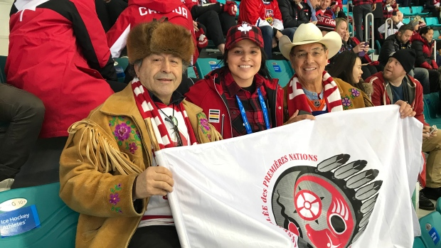 From left, Dene Chief Bill Erasmus, Team Canada's Brigitte Lacquette, and Cree Chief Willie Littlechild at the winter Olympics in South Korea. The chiefs were at the event discussing the possibility of a Team Indigenous at future Olympics. (Submitted by Bill Erasmus)