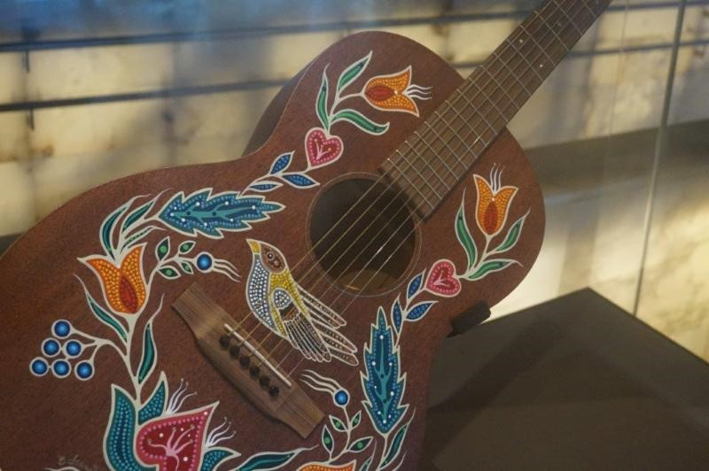 Metis-Guitar.jpg humnd rights museum metis tour lutheran indian ministries native news