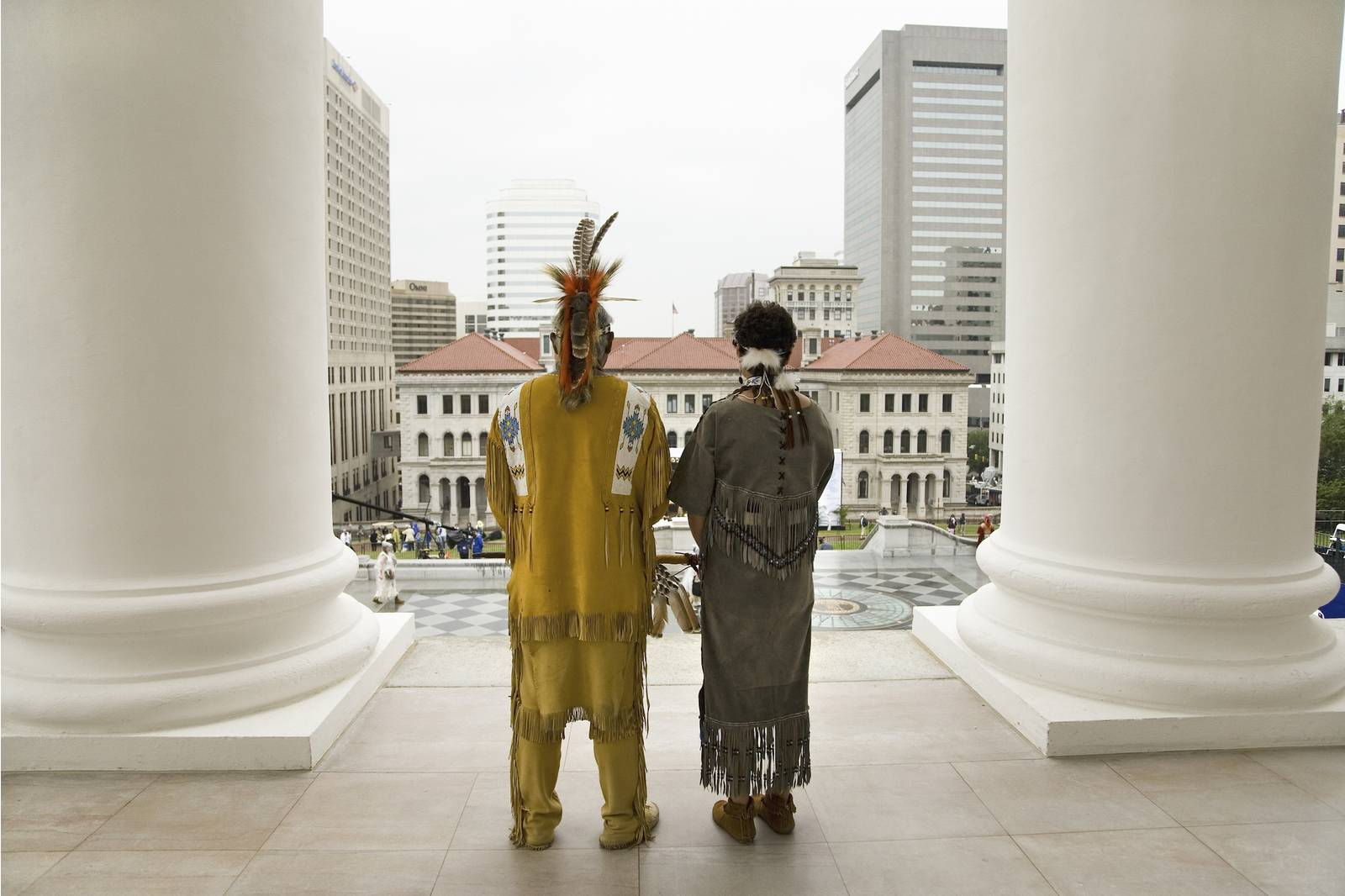 Two Powhatan Tribal members looking over Richmond, Va., from the State Capitol during ceremonies for the 400th Anniversary of the Jamestown Settlement on May 3, 2007. Joseph Sohm—UIG via Getty Images