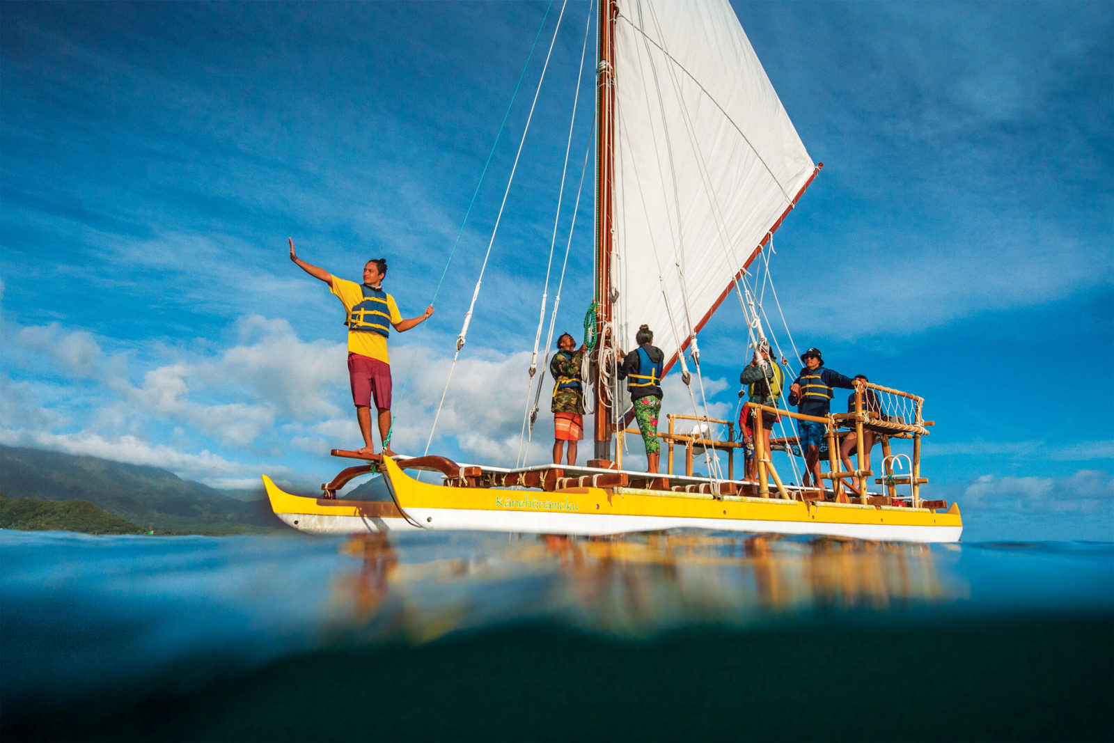Photography by Elyse Butler Mallams. Based at Kaʻalaea in Kāneʻohe Bay, Kānehūnāmoku, a 29ft double hull sailing canoe is a hands-on, dynamic, and living classroom for students of all ages.