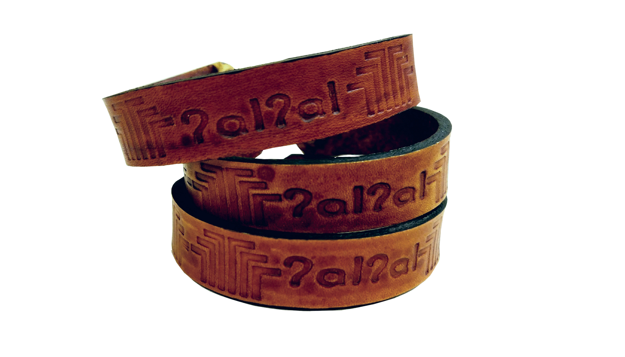 """These """"Home"""" Bracelets incorporate a traditional Native American basket design and are stamped with the Lushootseed word for """"home.""""Image Credit:Rob Bibelhauser"""
