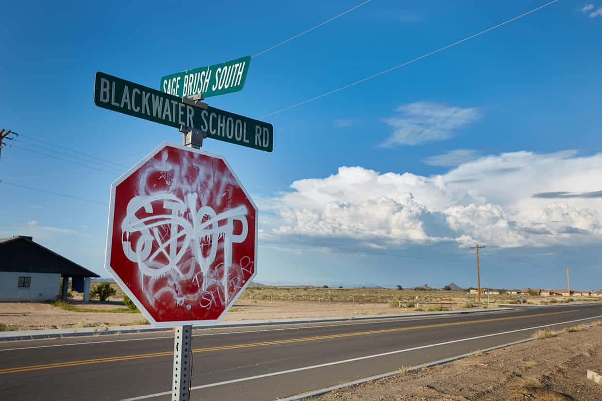 A stop sign covered in graffiti in Blackwater. Photograph: Steve Craft for the Guardian