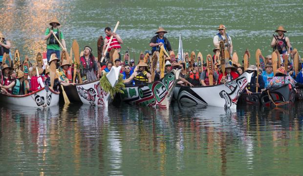 Canoes from around Southeast Alaska and Canada arrive at the Mike Pusich Douglas Harbor to participate in a Welcoming Ashore ceremony on Tuesday, June 5, 2018. The event, sponsored by the One People Canoe Society, is the unofficial start of Celebration 2018. (Michael Penn | Juneau Empire)