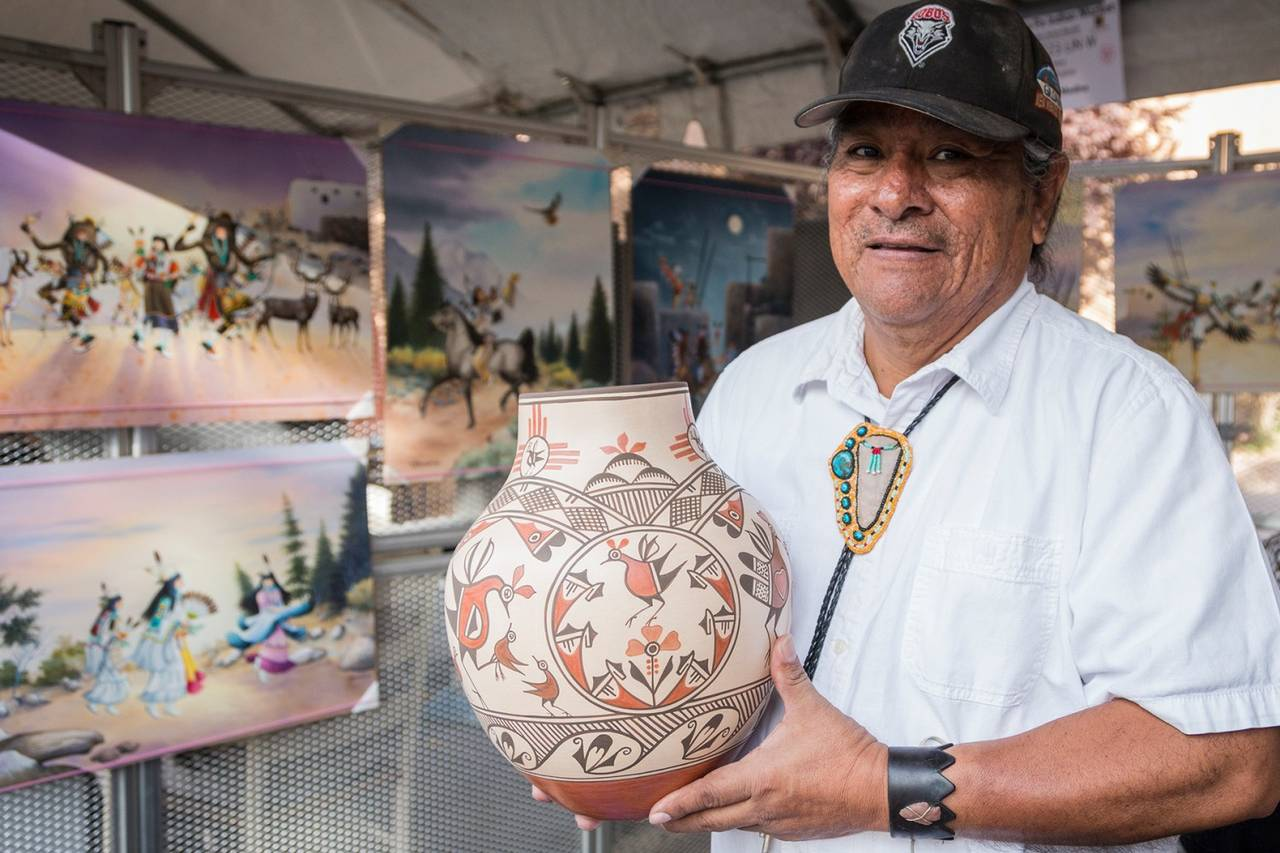 Marcellus Medina of the Zia Pueblo in New Mexico sells pottery and 2-D paintings at the Santa Fe Indian Market.PHOTO:GABRIELLA MARKS COURTESY OF SWAIA/SANTA FE INDIAN MARKET