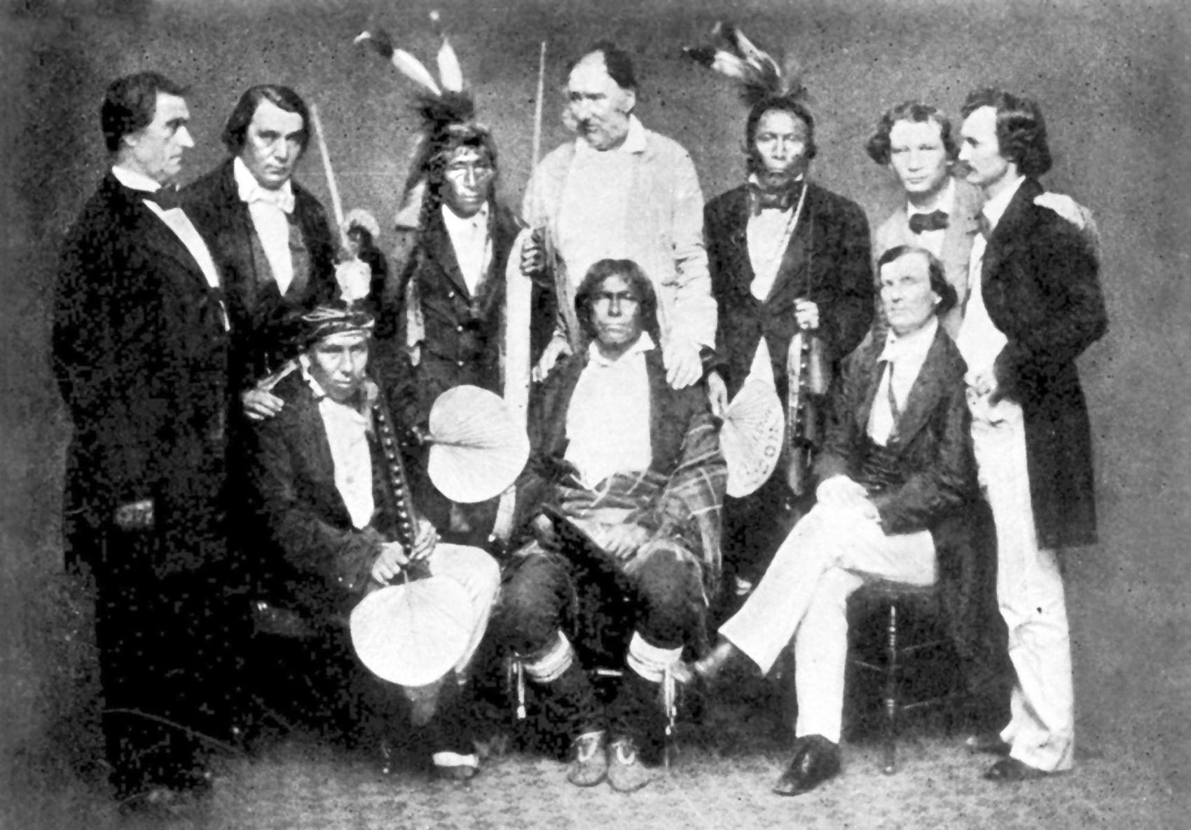 A meeting of whites and leaders of America's first people in 1858. Chief Wabasha III is seated in the center. Standing, from left: Joseph R. Brown, Antoine J. Campbell, Chief Has a War Club, Andrew Robertson, Chief Red Owl, Thomas A. Robertson and Nathaniel R. Brown. Sitting: Chief Mankato, Chief Wabasha III and Henry Belland. lutheran indian ministries native news