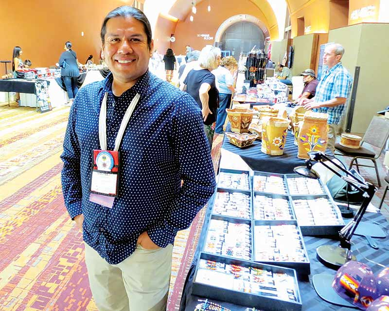 Special to the Times | Colleen Keane... Donovan Hanley, co-owner of DETOURS American West, at the American Indian Alaska Native Tourism Association conference at the Isleta Resort and Casino. lutheran indian ministries native news