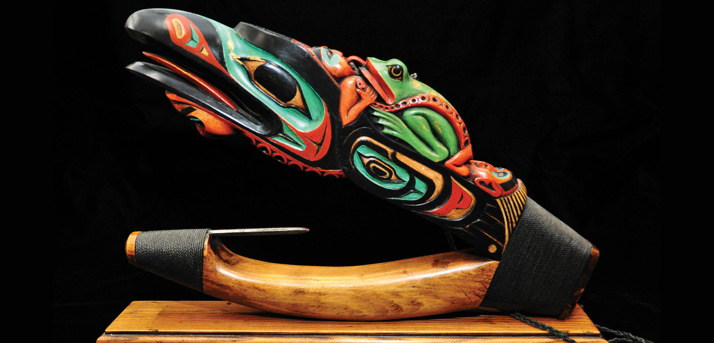 Tlingit artist Arthur B. Nelson's Devil Fish Halibut Hook, 2012, is an impressive example of a contemporary wooden halibut hook designed to be a piece of art rather than a functional example of halibut fishing equipment. The carving depicts raven, frog, octopus, and human spirits. Photo by Kathy Dye, courtesy of Sealaska Heritage Institute