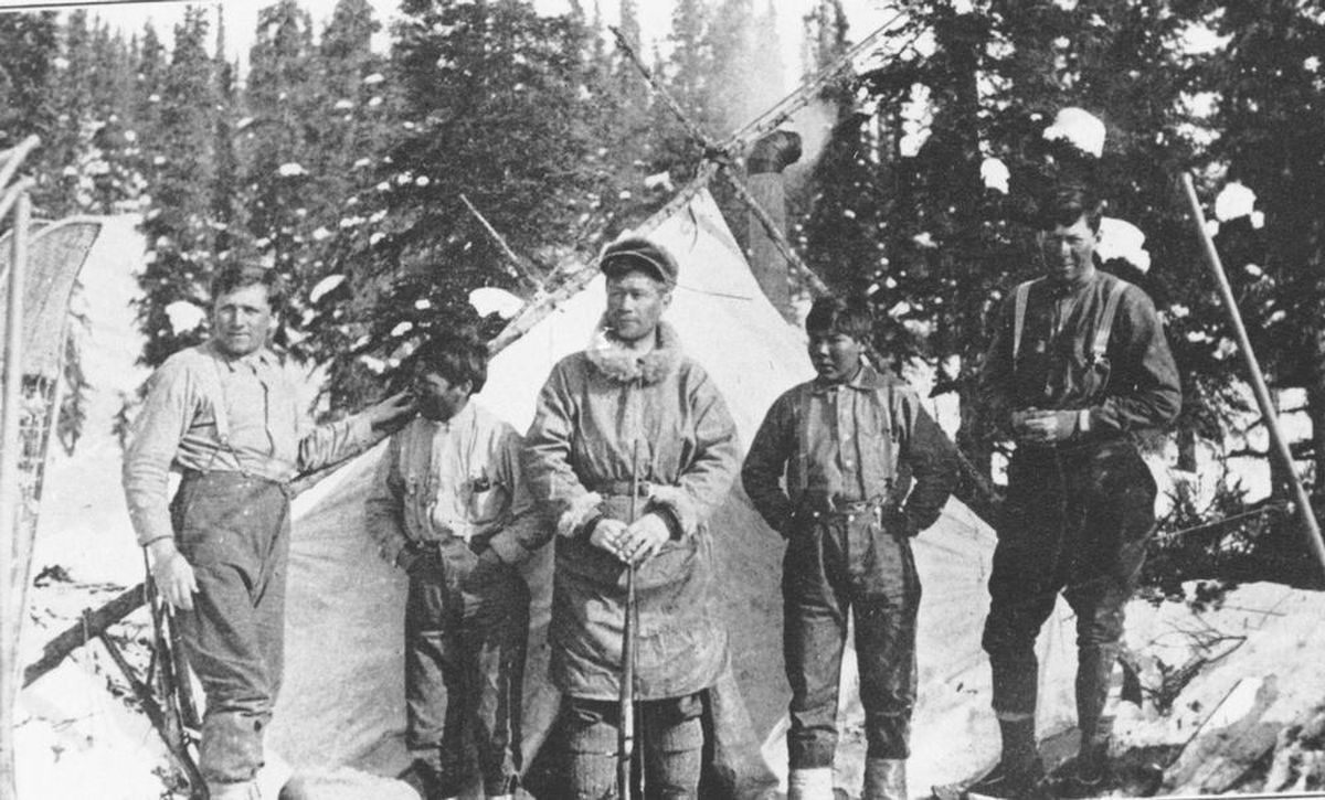 Robert Tatum, Esaias George, Harry Karstens, John Fredson and Walter Harper gather at base camp for a photo believed to be taken by Hudson Stuck at the start of the historic 1913 ascent of Denali. George drove a dog team back to Nenana after helping supply the expedition and Fredson kept the camp ready for the climbers' return. (Photo courtesy Denali National Park and Preserve archives) lutheran indian ministries native news