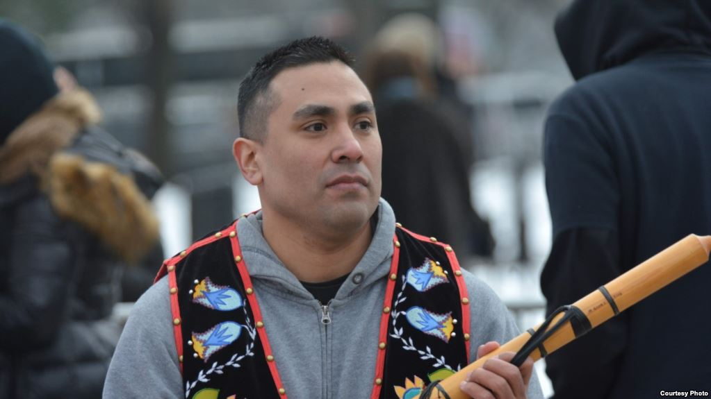 lutheran indian ministries native news - Ojibwe flutist Darren Thompson at the Indigenous Peoples March in Washington, D.C., Jan. 18, 2019. (Photo by Mike Garcia)