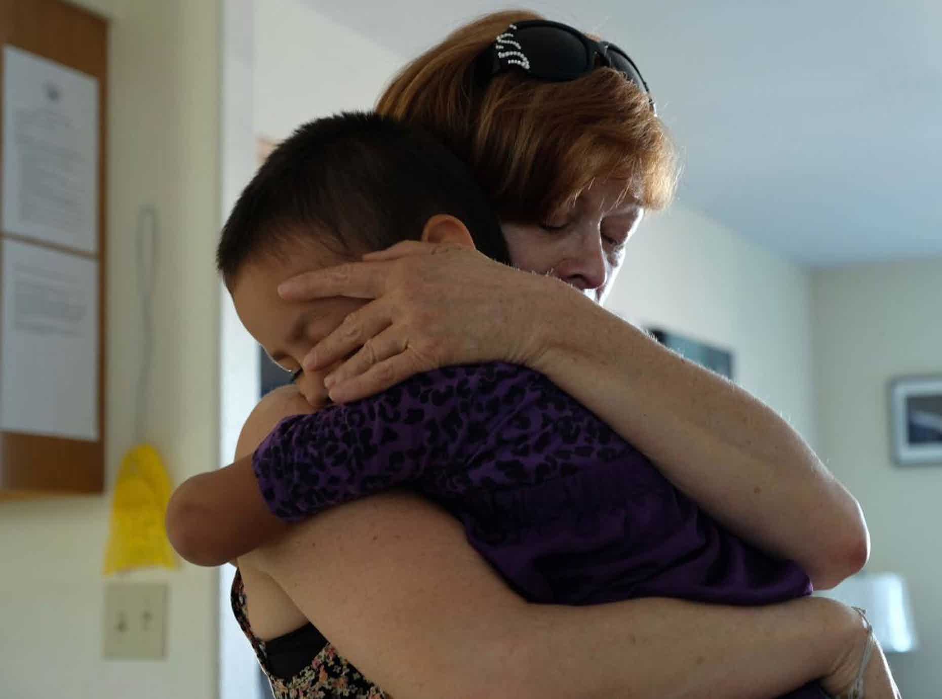 lutheran indian ministries native news - Film star Frances Fisher holds unknown child during True Sioux Hope Foundation 2017 tour of children's Safe Home. (Photo by Mary Annette Pember)