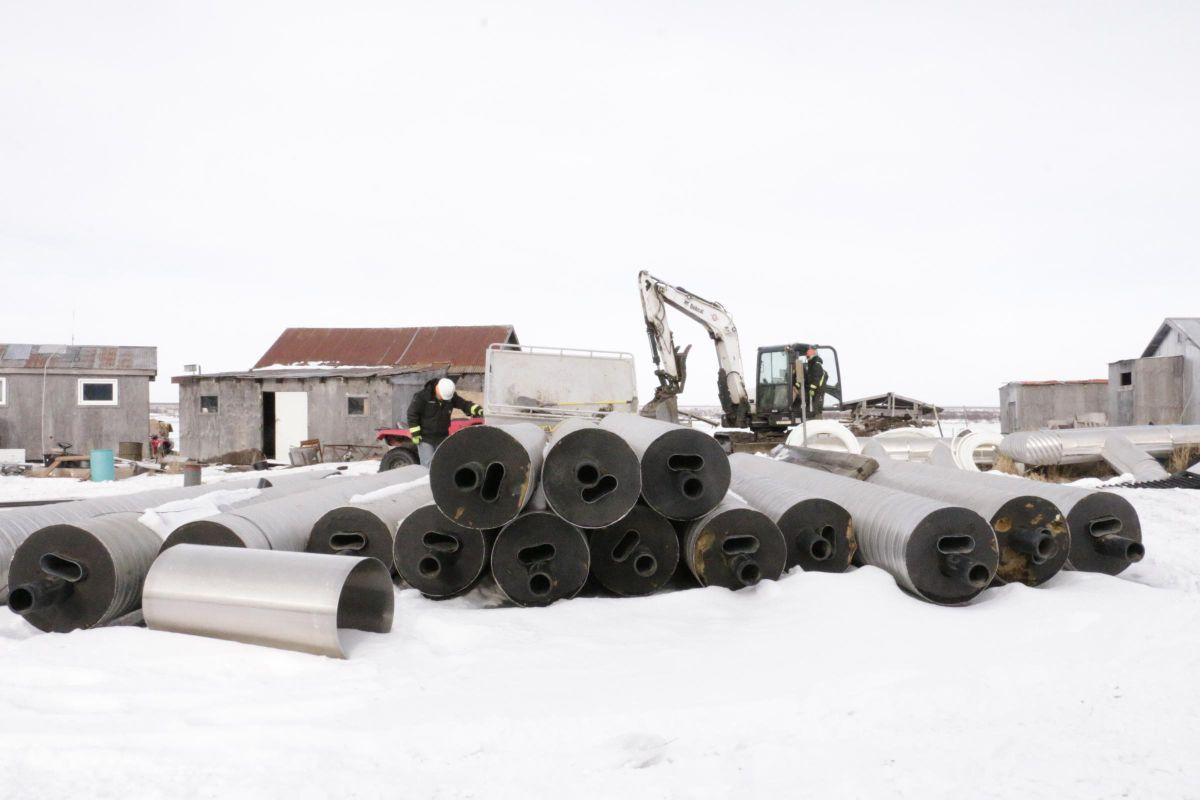 ANTHC crews prepare to bury water lines in Eek on February 20, 2019. (Anna Rose MacArthur / KYUK)