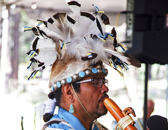lutheran indian ministries native news - This 2017 photo provided by the Museum of Northern Arizona shows an unidentified man wearing a headpiece fashioned out of an animal hide at the Navajo Festival of Arts and Culture in Flagstaff, Ariz. The hide did not come from a state wildlife repository, but the photo shows how Native Americans use animal parts for religious and cultural purposes. Arizona wildlife officials are on the lookout for bear, bison, badger and other carcasses for Native Americans' religious and cultural use under a unique new program that allows tribes to make requests for various animal parts. (Ryan Williams/Museum of Northern Arizona via AP)