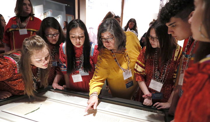 lutheran indian ministries native news - Members of the Cherokee Youth National Choir taking part in the installation of the Treaty of New Echota at the National Museum of the American Indian in Washington, D.C. (Paul Morigi/AP Images for the Smithsonian)