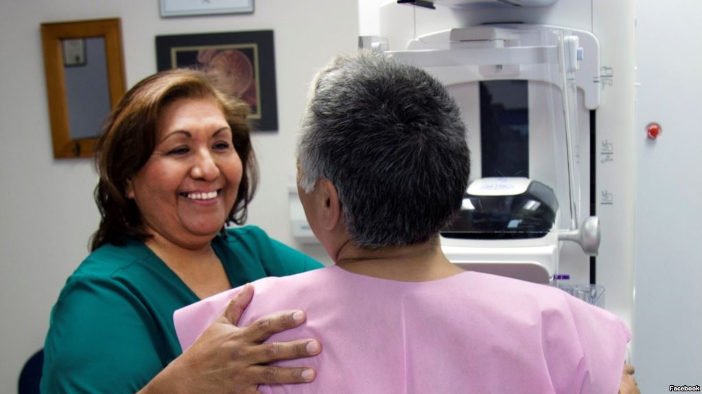 Photo shows a patient at the Phoenix Indian Medical Center (PIMC) preparing for a mammogram. Facebook/Indian Health Service/PIMC
