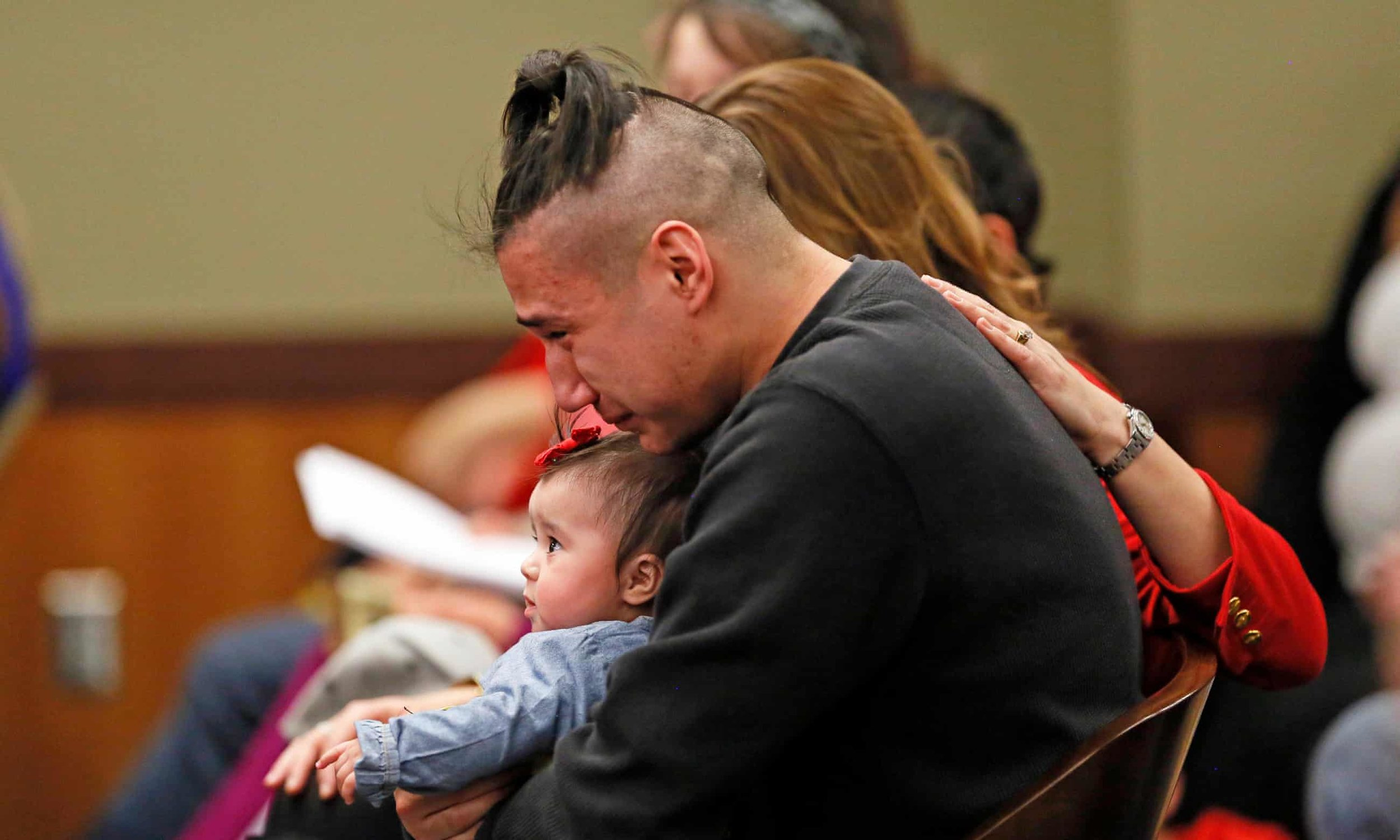 Savanna LaFontaine-Greywind's boyfriend Ashston Matheny holds their daughter, as victim impact statements are read during the sentencing of Brooke Crews. Photograph: David Samson/AP