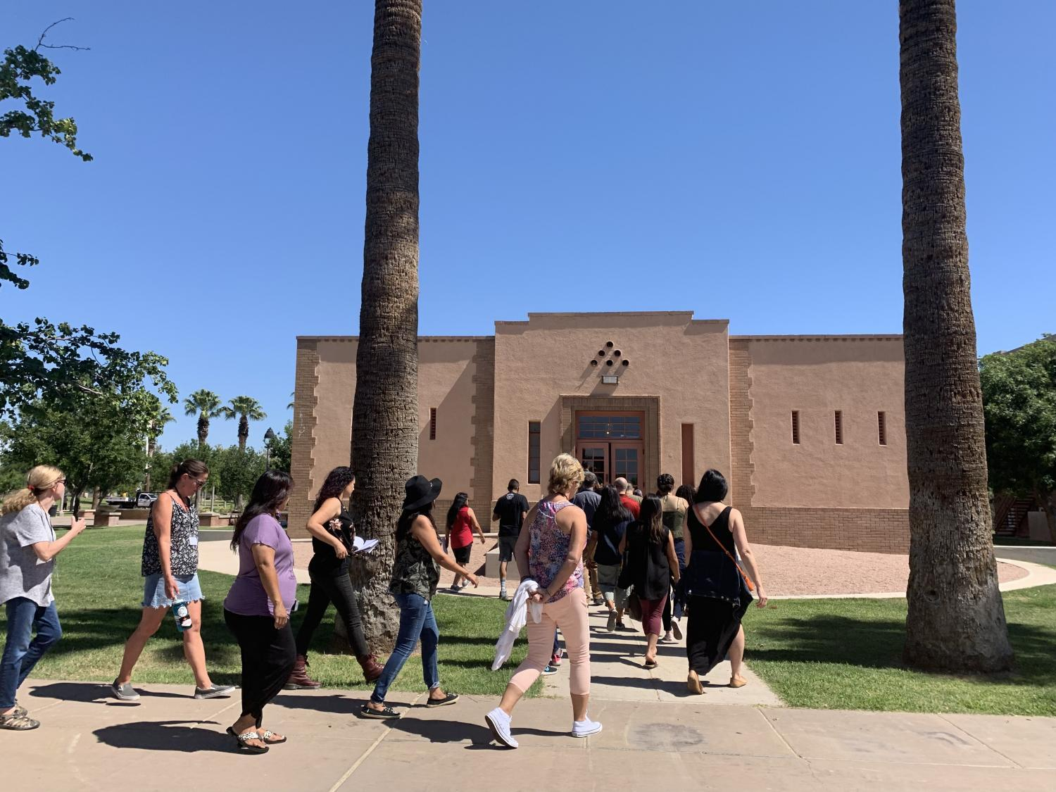 Teachers walk into the Phoenix Indian School Visitor Center on the second day of the three-day Teacher Institute. ( Mariana Dale/KJZZ)