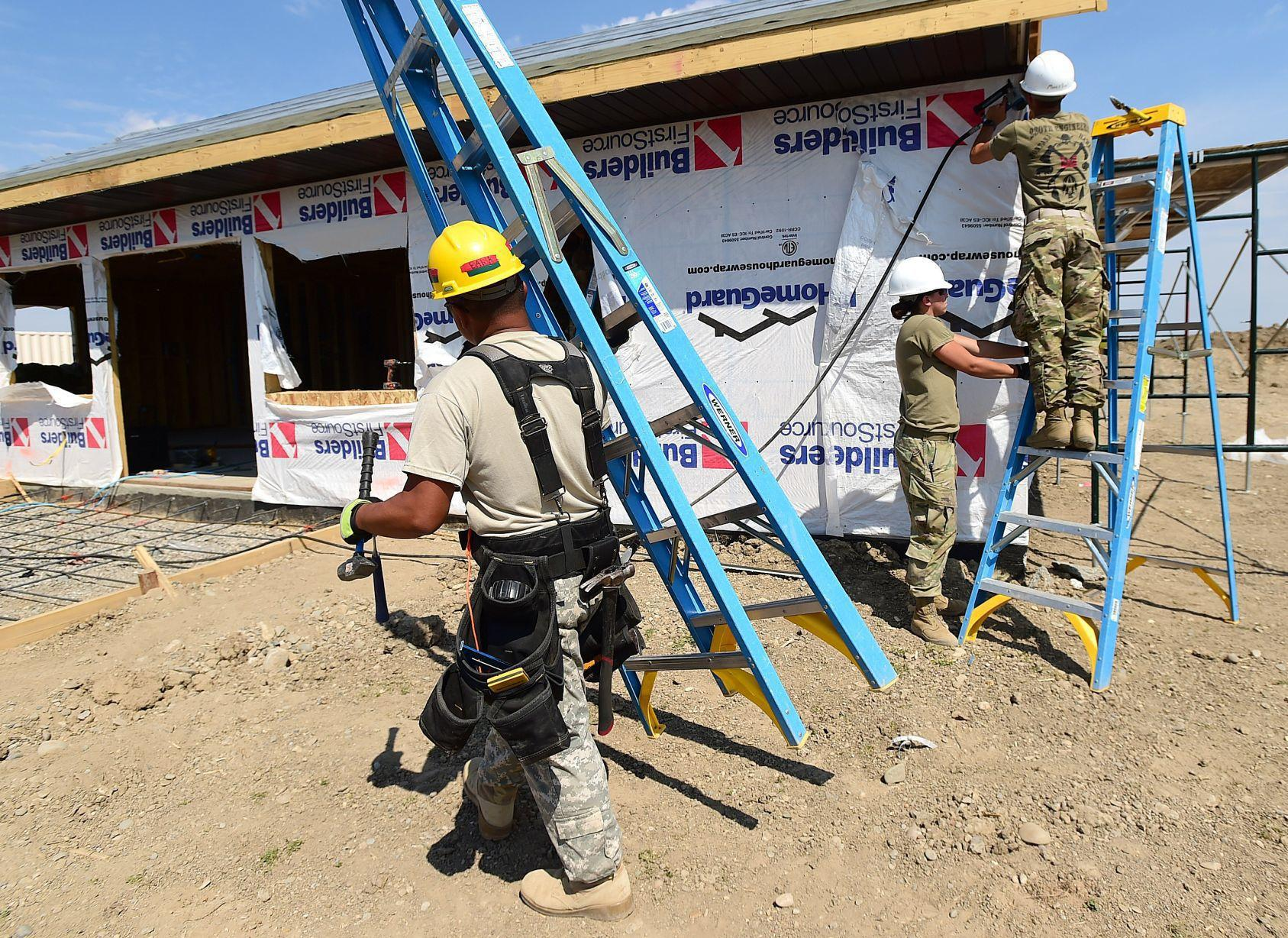 Montana and Hawaii Army National Guard 260th and 230th Engineers build a new home in the Apsaalooke Warrior Apartments near Crow Agency. From left, Sgt. Josiah Baisa, Spc. Johanna Lembke and Sgt. Benjamin Rinke work on the home on Tuesday. LARRY MAYER, Billings Gazette