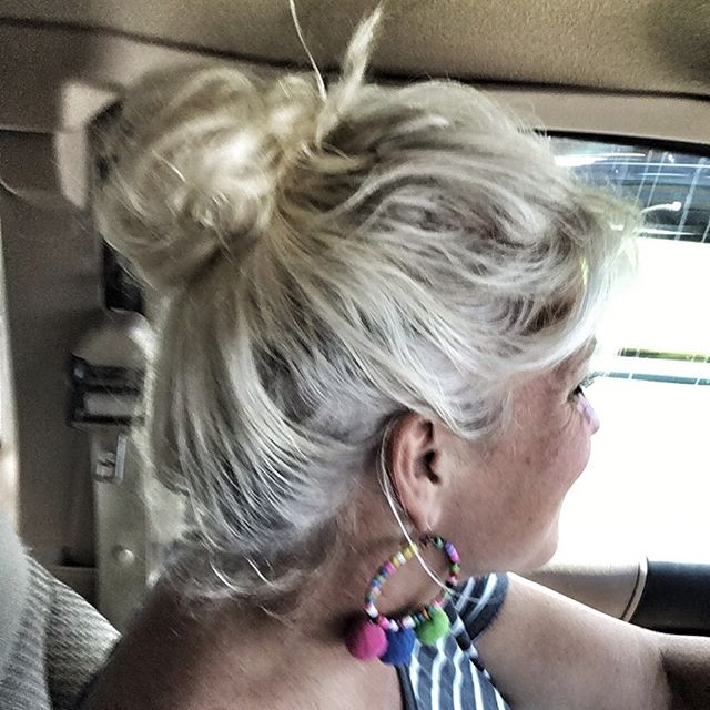 My first bun in over 20 years! In my 20s, I used a bun to look mature when I felt so young, and now in my 50s, I have tried it again because it feels as youthful as I feel. Aren't we funny the way we feel completely differently after so many years? But I don't know what I want to do about all the funky colors underneath. I'm outside a lot, so the top gets whitened, but the hidden hair doesn't see the sun and is multi shades. (I put a filter to accentuate all the shades.) Thoughts?