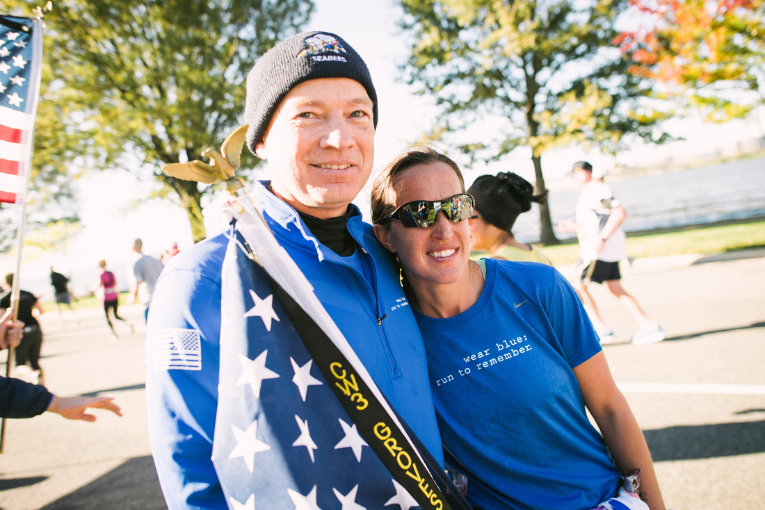 Phillip Cyr and Katie Groves share a moment on the wear blue Mile at the 2014 Marine Corps Marathon. Photo courtesy Ingrid Barrentine of Grit City Photography.