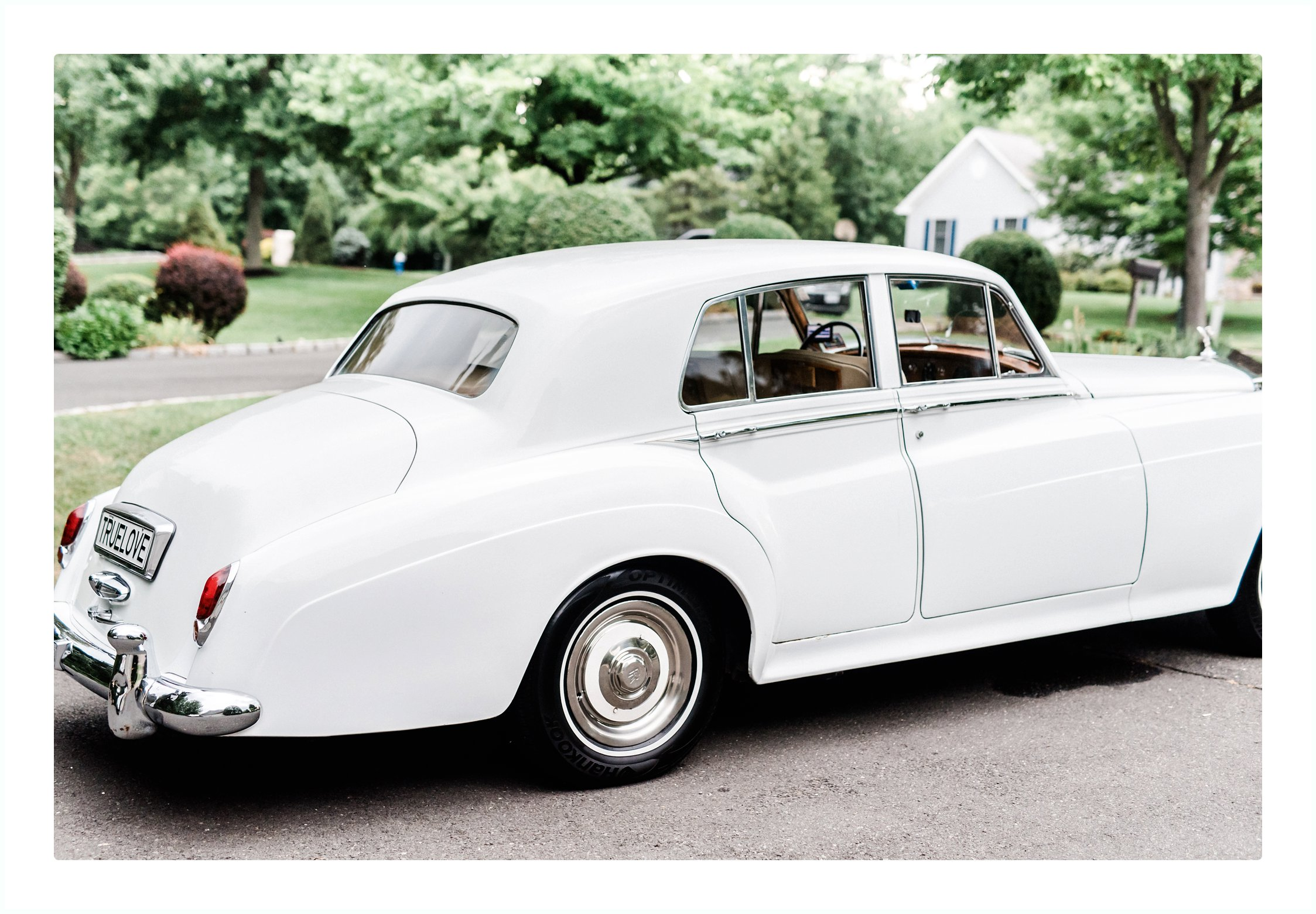 white rolls royce car for a wedding day at park savoy in florham park new jersey
