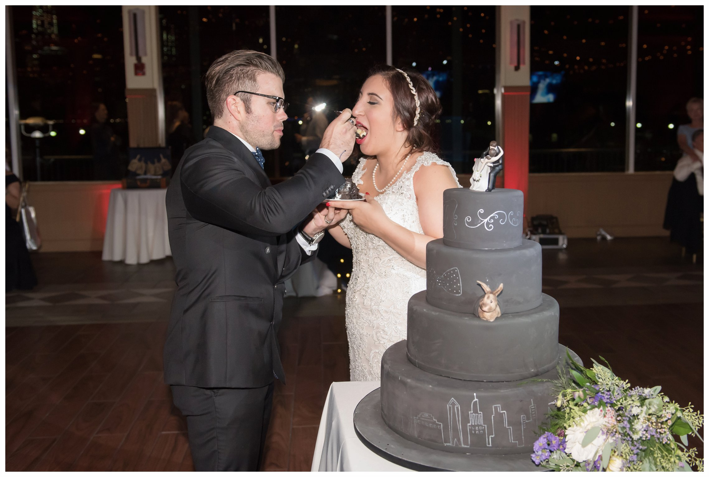 bride and groom cake cutting at the wedding at the liberty house restaurant in jersey city new jersey
