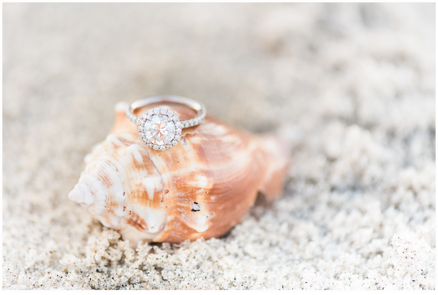 engagement ring in the sand