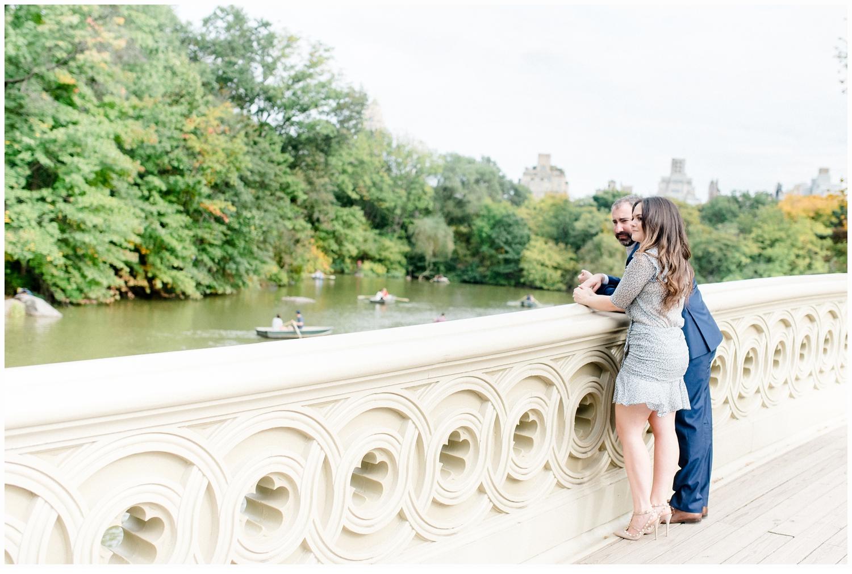 engaged couple on bow bridge