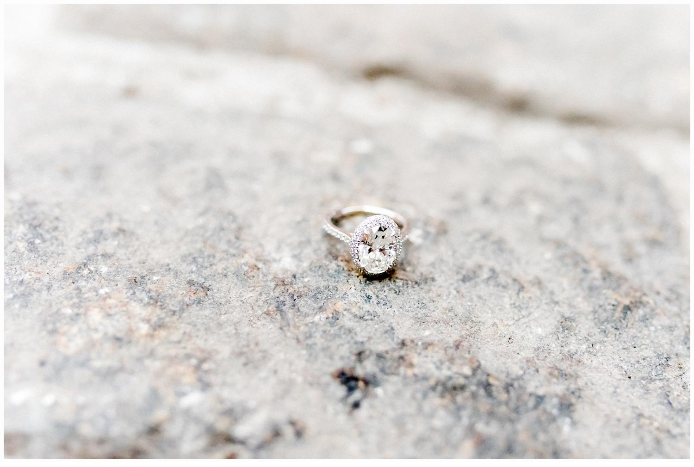 engagement ring on cobblestone street