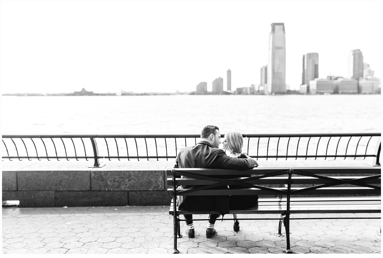 engaged couple by battery park city waterfront