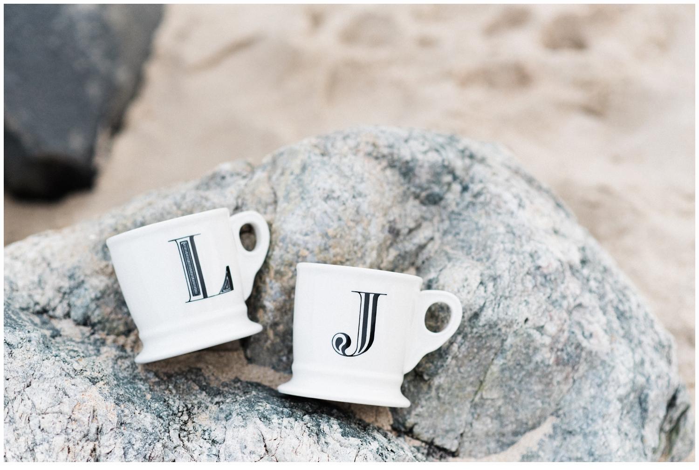 coffee mugs on rocks on beach