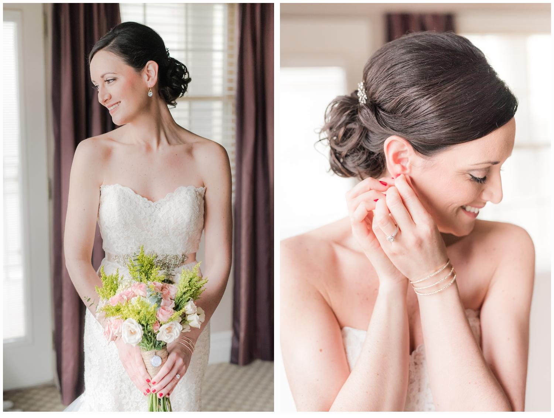 bride putting on earrings in bridal suite