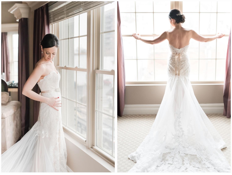 bride posing at window in bridal suite