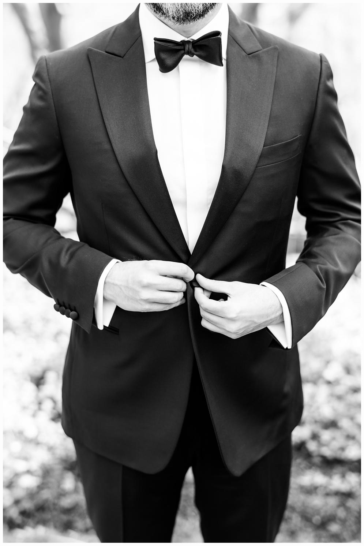 groom in black tux on wedding day