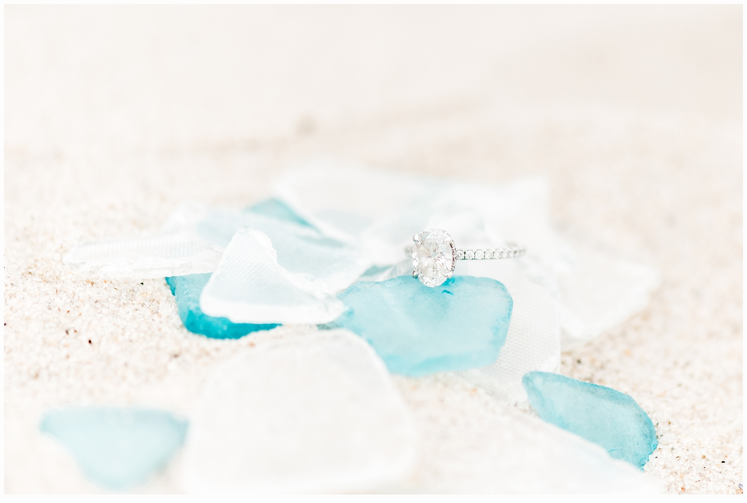 engagement ring on sea glass