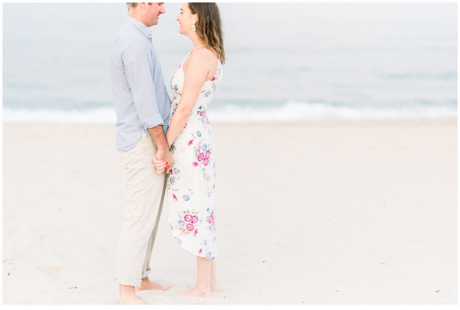 couple on beach holding hands