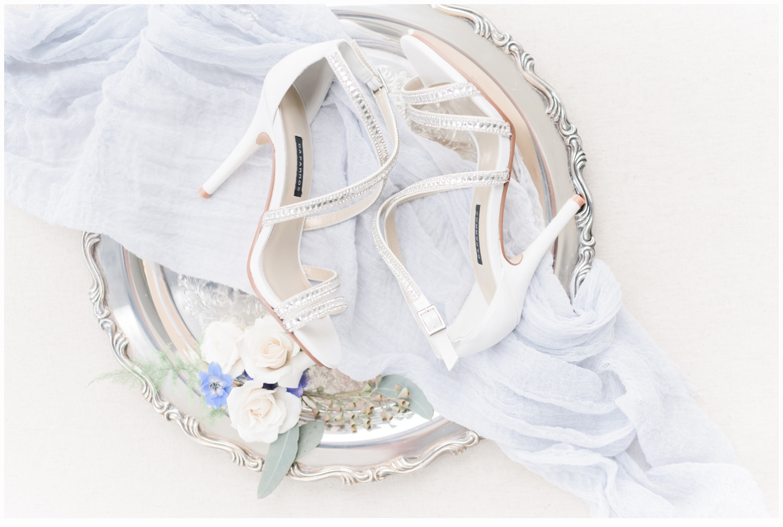 wedding shoes on pretty silver tray