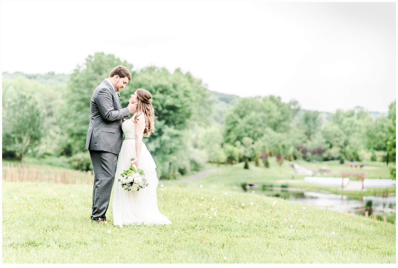bride and groom wedding portraits in field