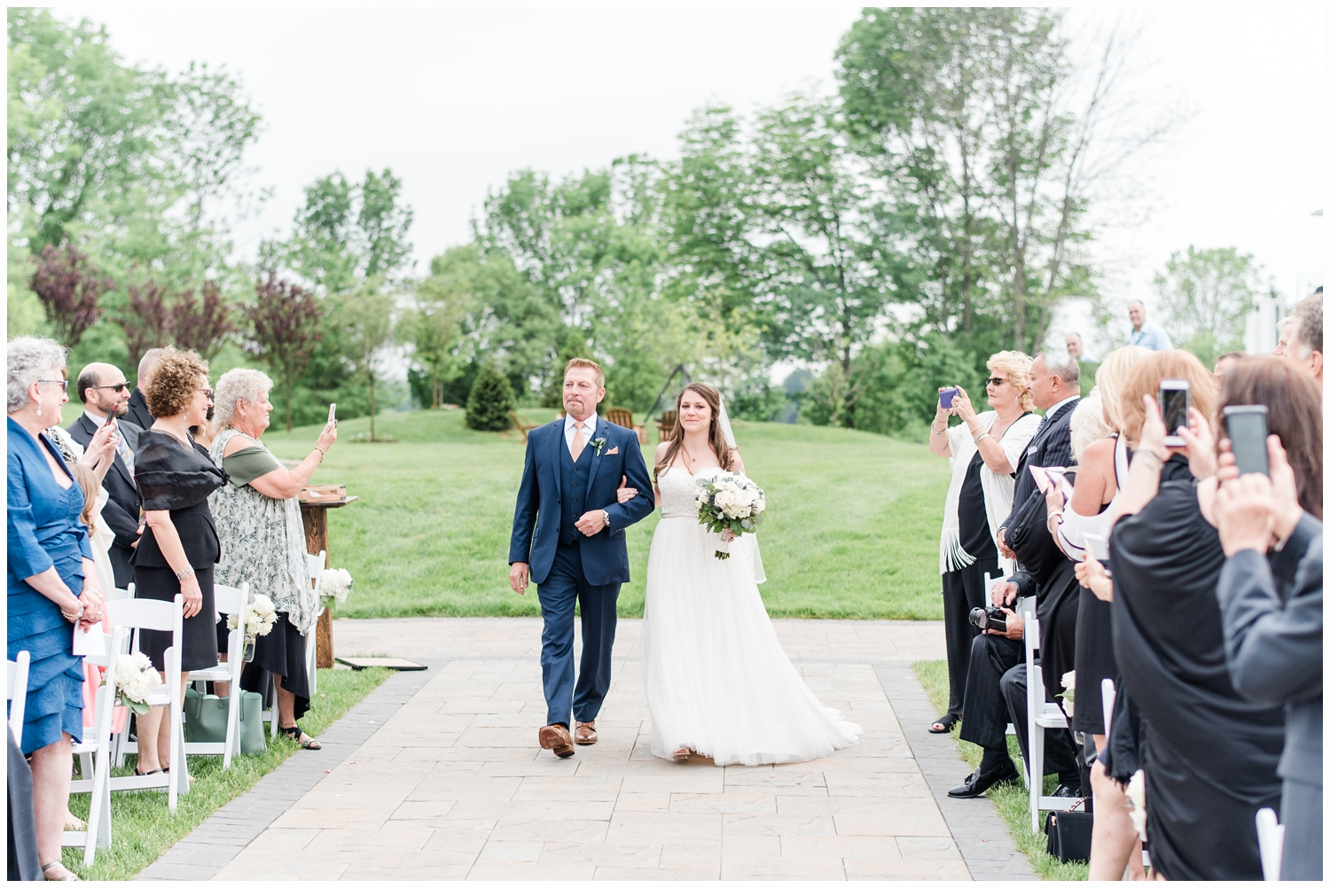 bride and father walking down aisle at wedding
