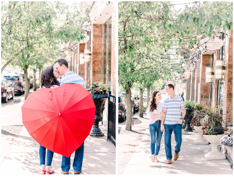 couple kissing behind a heart umbrella
