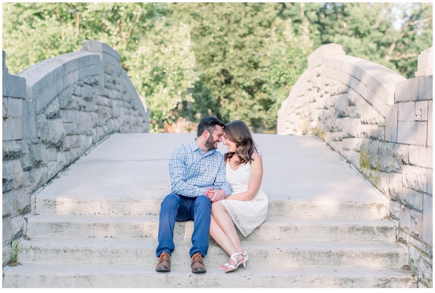 engaged couple hugging on steps