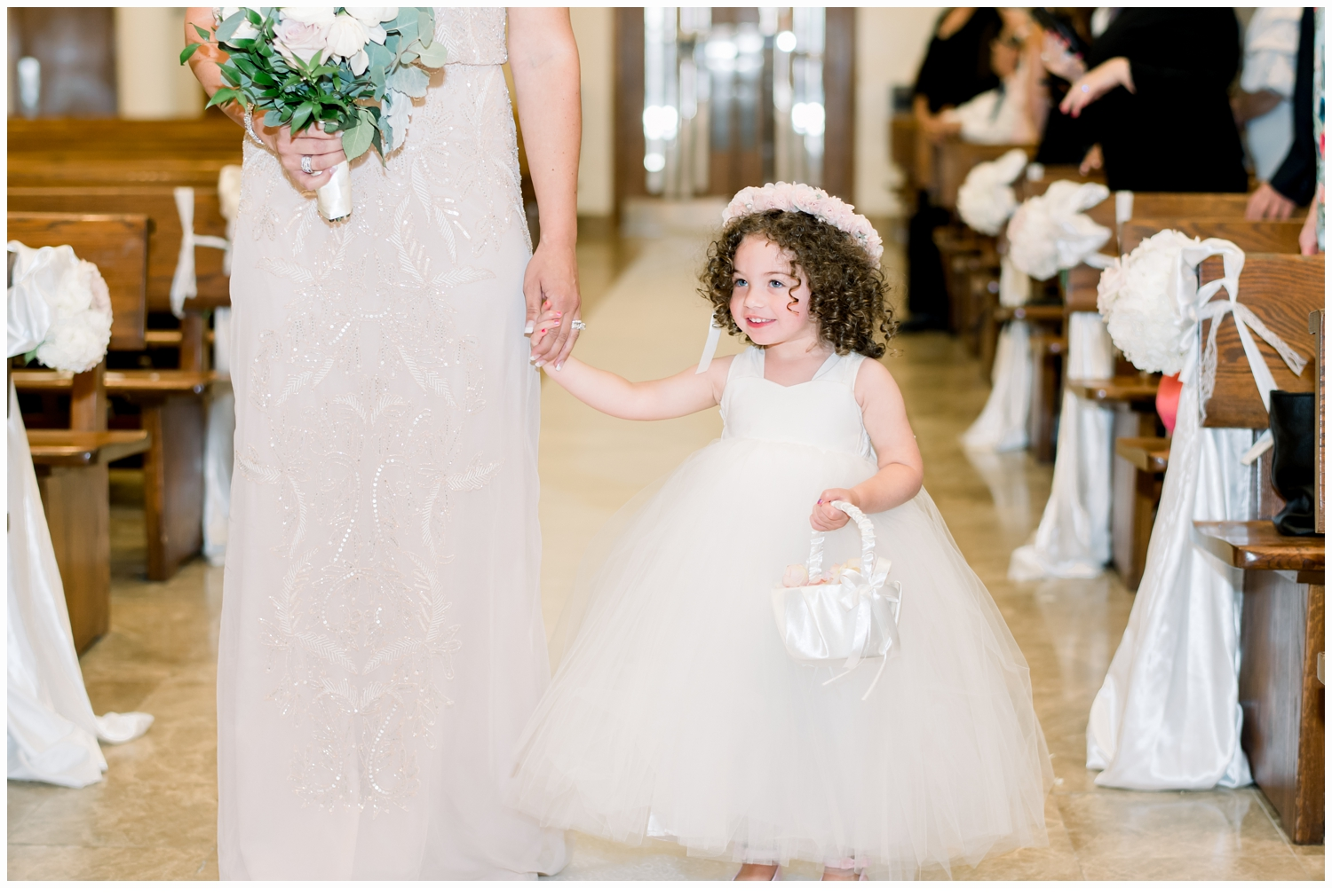 flower girl coming down aisle in church